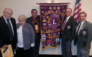 District Governors from Abington Lions Club include Ed Klovensky, Ethel Neary, Mark Kusma, Current District Governor Joe Skinner, and Ed Borek (not pictured).  At right is First Vice District Governor Gene Sciliotti